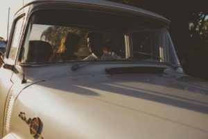 Lovers in a vintage Ford